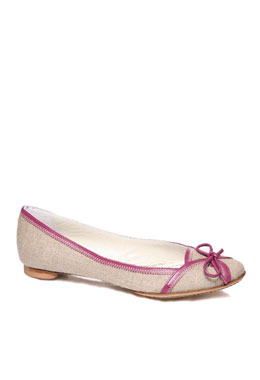 tied leather shoelace. The shoe is trimmed with purple leather with