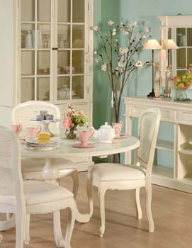 Nouvelle cream round dining table for Cream kitchen set