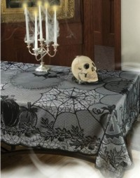 Dress your table in classic gothic black lace this Halloween. Put this lace tablecover over the top of a lighter tablecloth to see the pattern at best effect. It should cover a table approx 28inches by 46 inches up to one measuring 40 inches by 58 in - CLICK FOR MORE INFORMATION