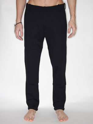 Really brilliant simple navy slim leg trousers from Jil Sander in a stretch jersey. Trousers has small turn up, four pockets (2 front and 2 back) and a zip fly. Subtle and cool, they embody the Jil Sander look brilliantly. - CLICK FOR MORE INFORMATION