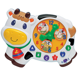 Interactive, cow shaped clock with easy-to-press buttons to encourage samll hands to explore - CLICK FOR MORE INFORMATION