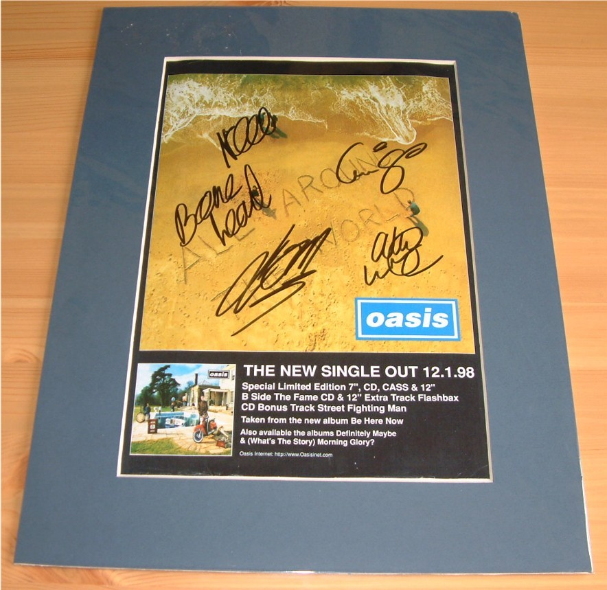 OASIS - GROUP SIGNED & MOUNTED MAG ADVERT PAGE -