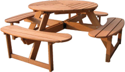 Round pine picnic table with four rounded fixed seats fromt he Shaftesbury Range of Furniture. - CLICK FOR MORE INFORMATION