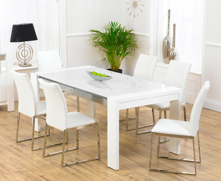 A High Quality Glass Dining Table With Brushed Metal