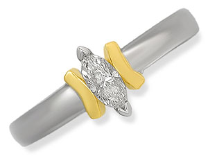 `White and yellow gold together create this modern, eye-catching ring. At its centre a lovely marqui