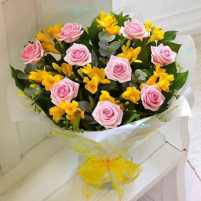 This classic combination of delicate scented Freesia, nine large-headed Roses and choice foliage can